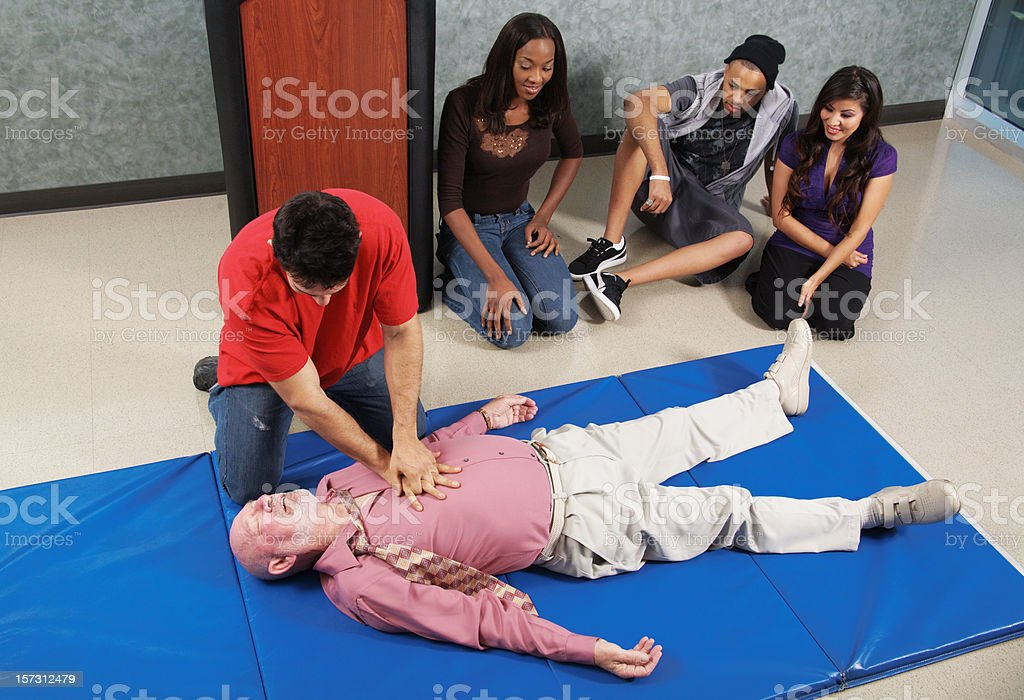 CPR Chest Compressions royalty-free stock photo