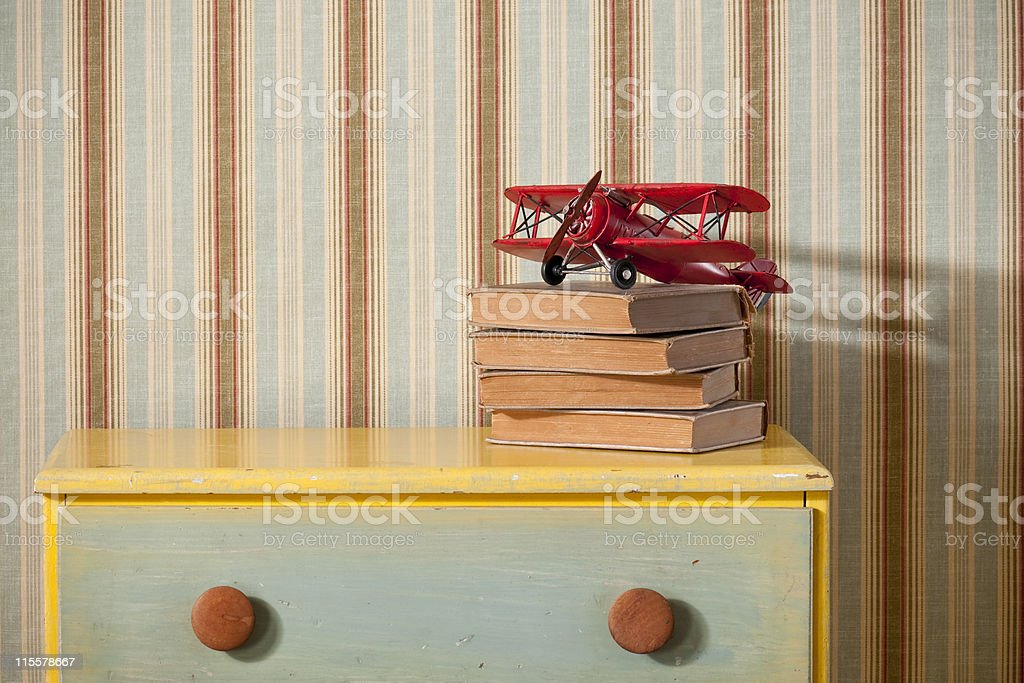 Chest Of Drawers With Books in Empty Bedroom royalty-free stock photo