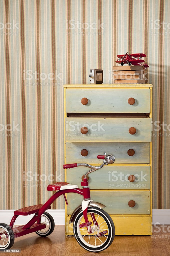 Chest Of Drawers With Red Tricycle stock photo