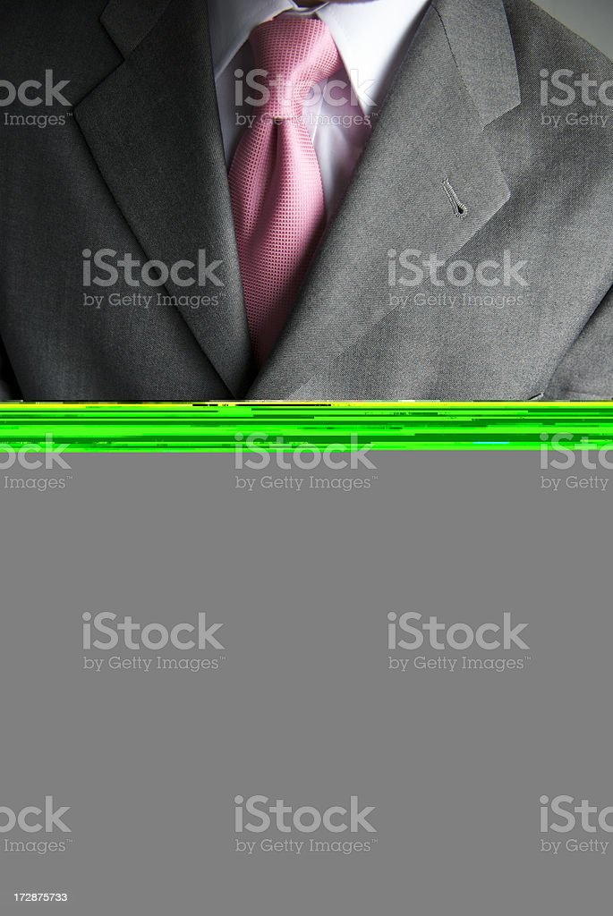 Chest of man in suit with blank gray block below royalty-free stock photo