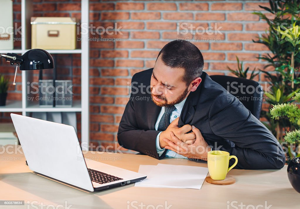 Chest pain at the office stock photo