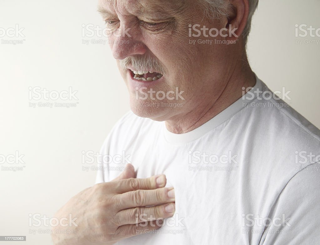 chest pain in older man stock photo