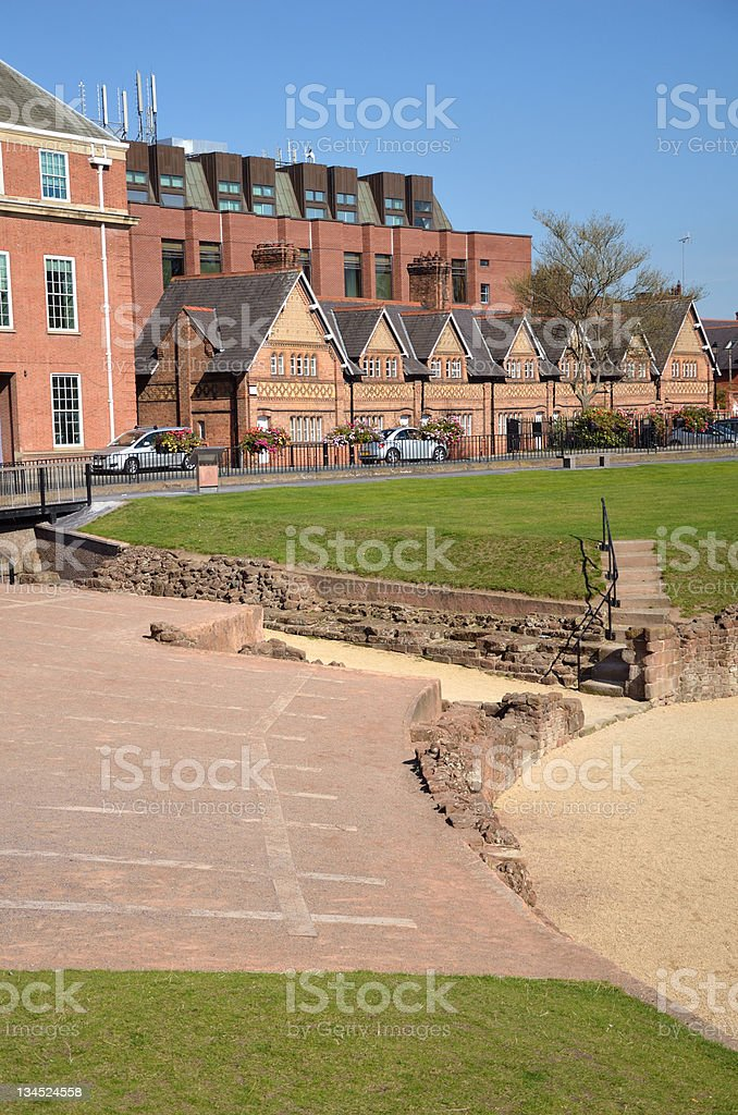 Chester's Roman Amphitheatre and Victorian Houses royalty-free stock photo