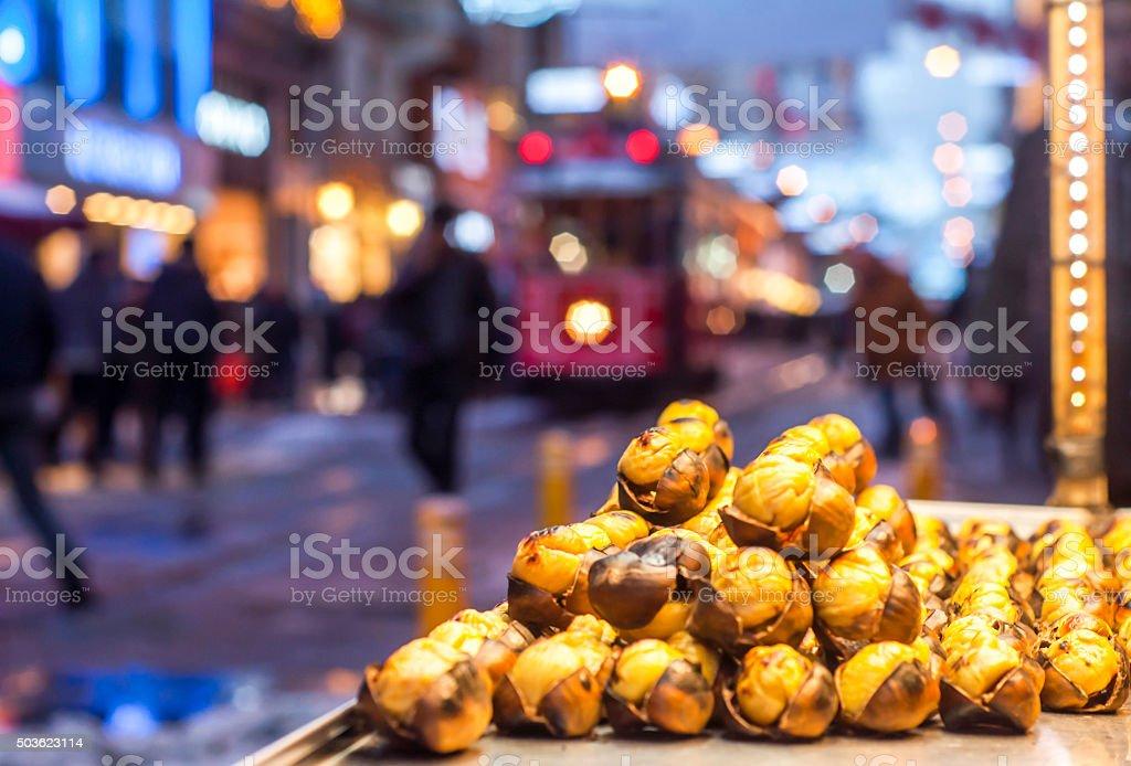 Chestnut seller on Istiklal Street. Istanbul, Turkey. stock photo
