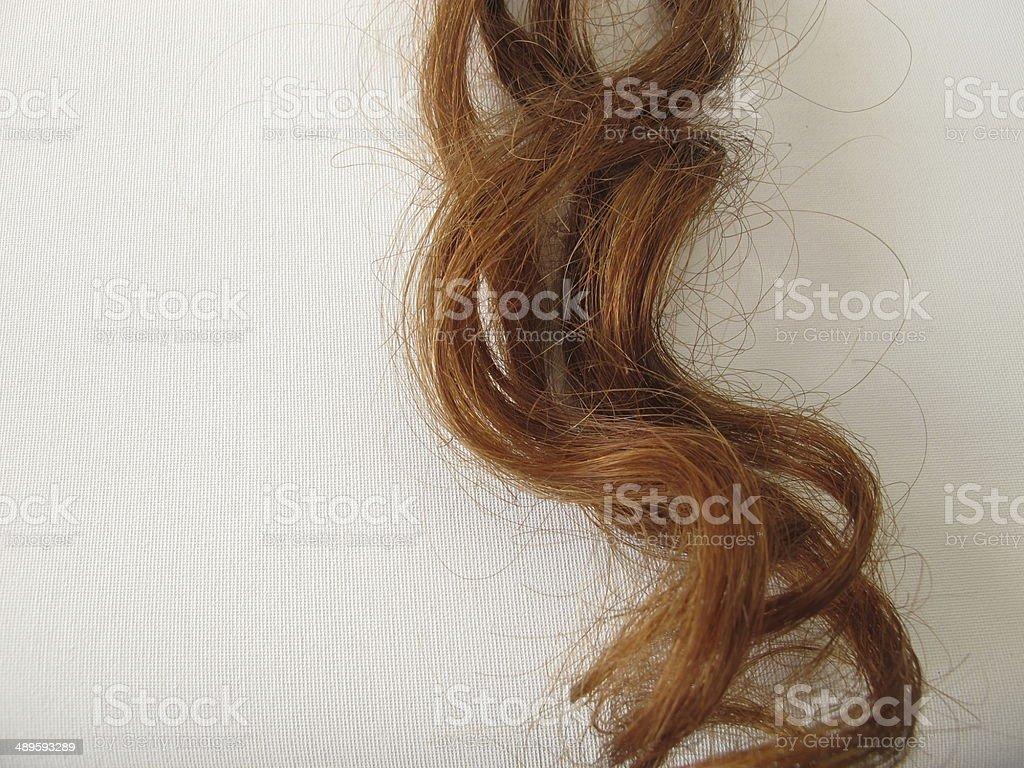 Chestnut-brown hair strand stock photo