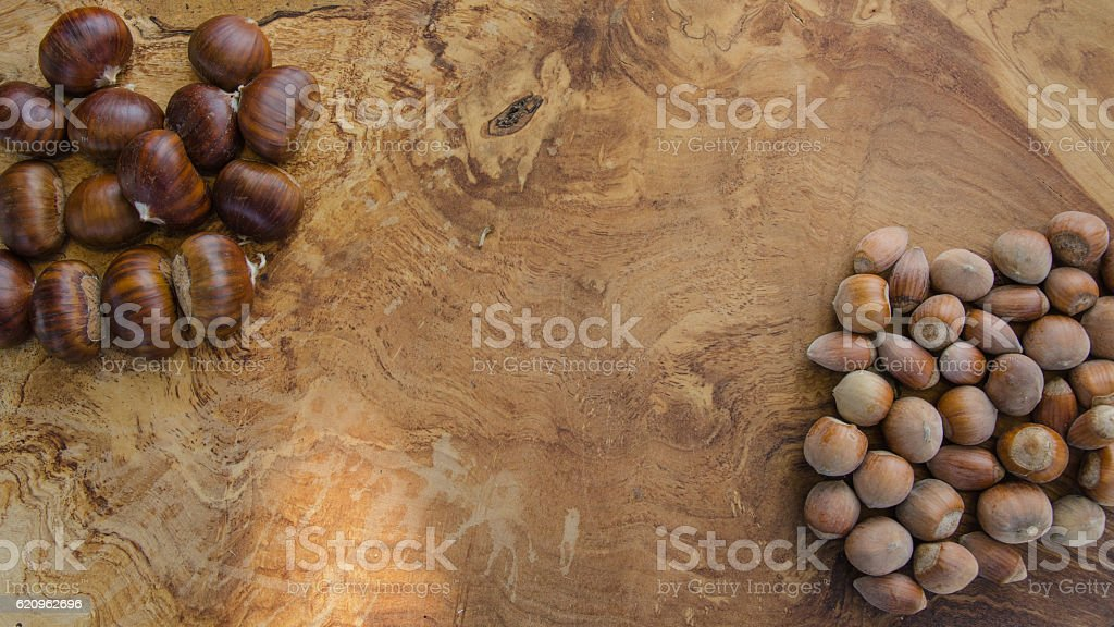Chestnuts and hazelnuts on wood table royalty-free stock photo