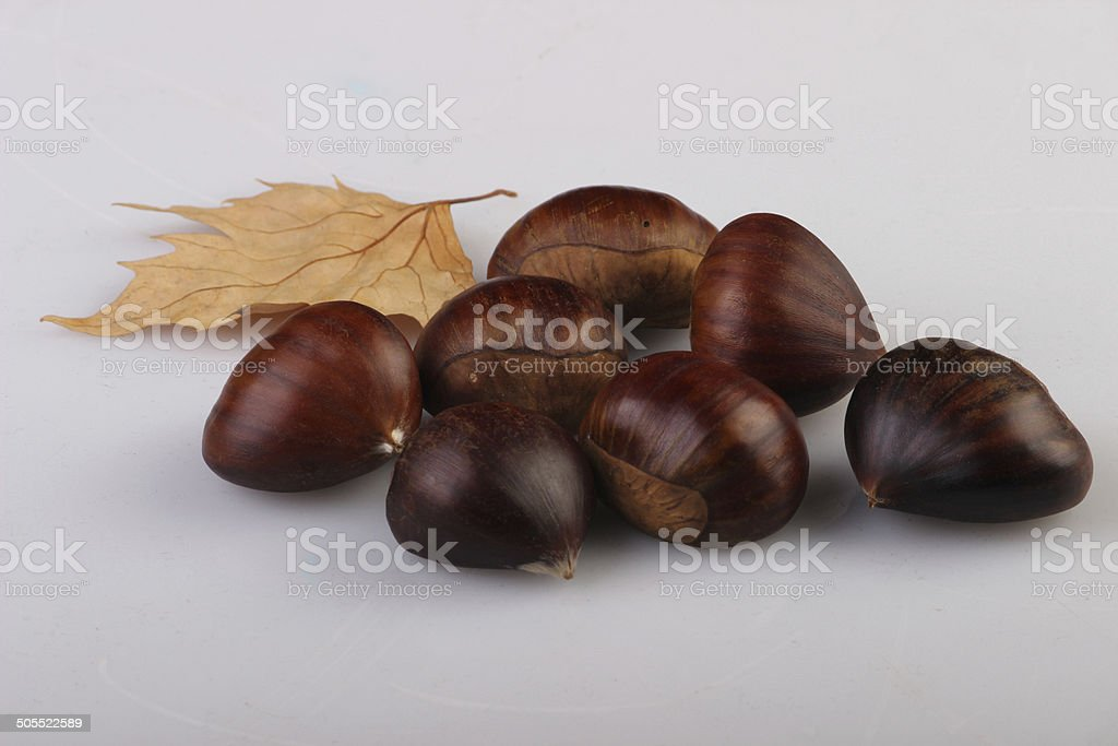 chestnuts and leaves royalty-free stock photo