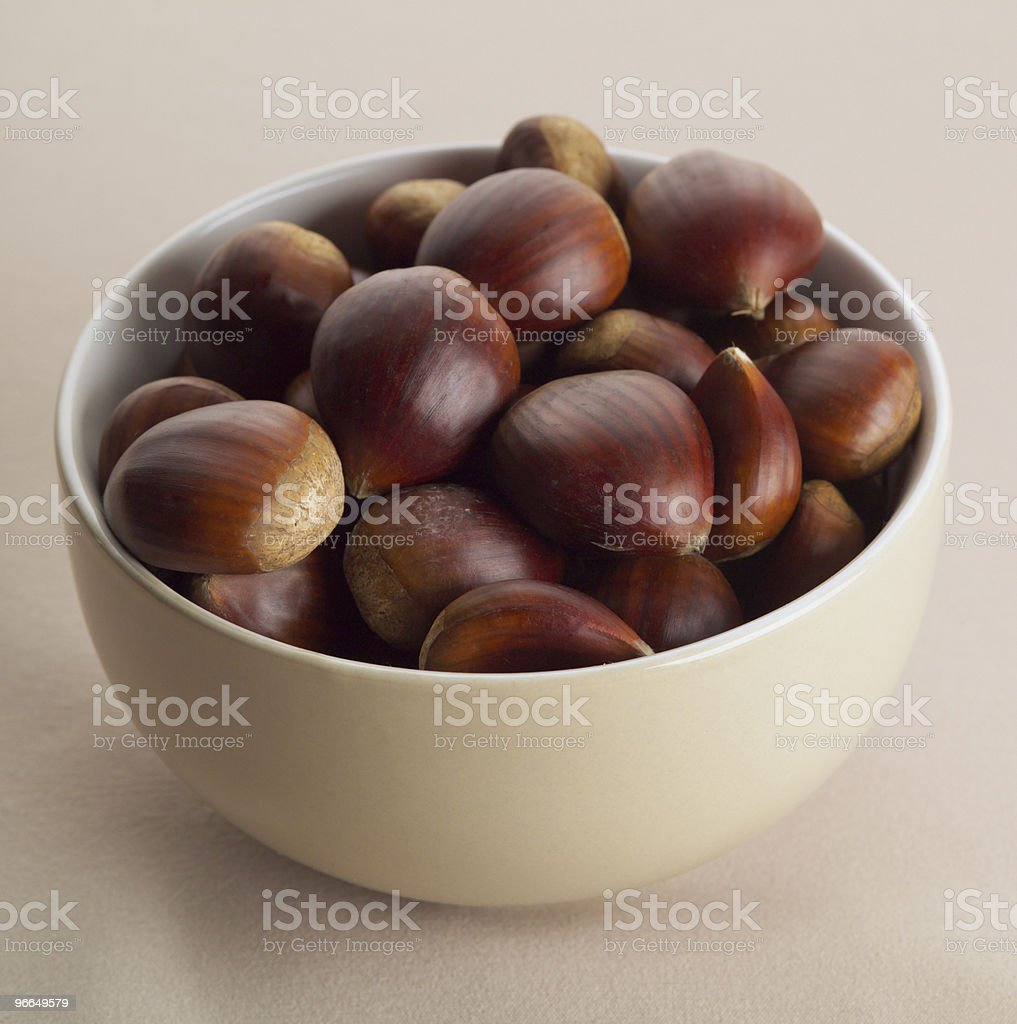 chestnuts in a bowl stock photo