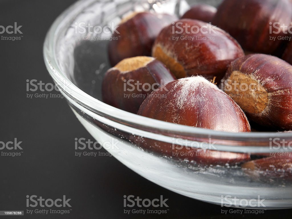 Chestnuts in a glass basin royalty-free stock photo