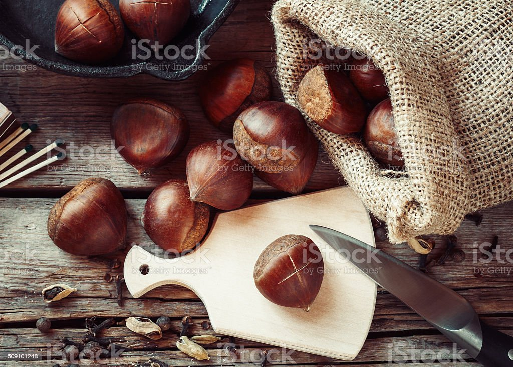 Chestnuts ready to roasting and frying pan stock photo