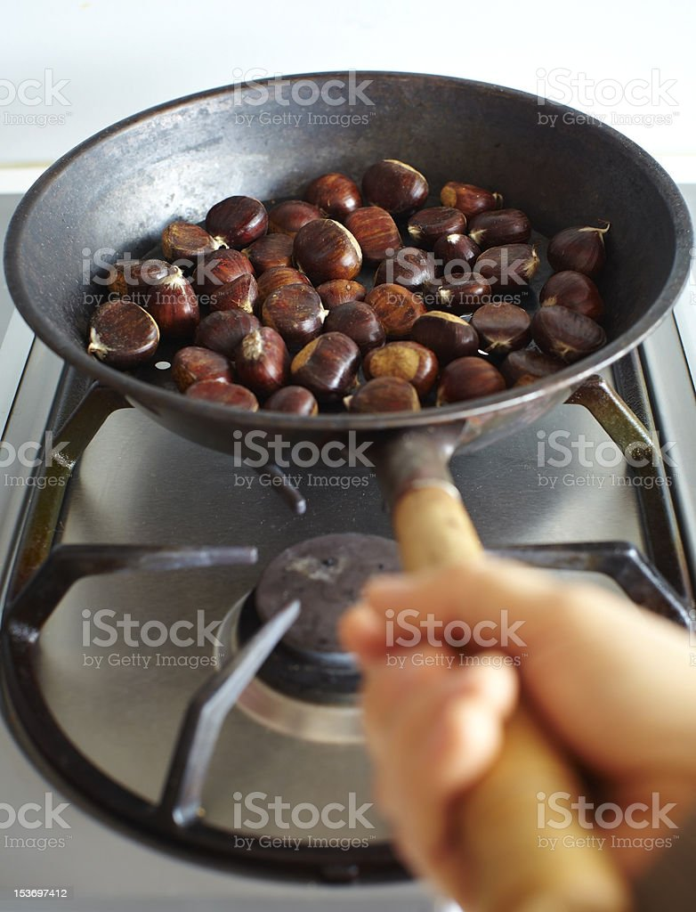 Chestnuts roasting on a fire royalty-free stock photo