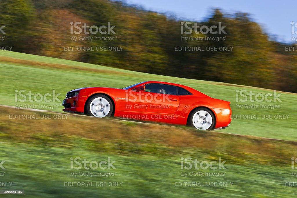 Chevrolet Camaro driving stock photo