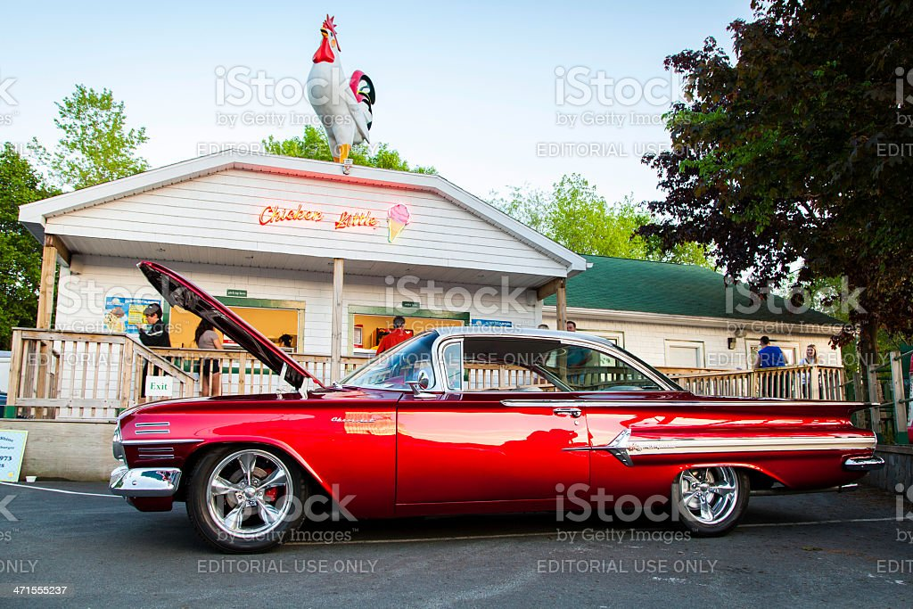 Chevrolet Impala in Front of Ice Cream Parlor stock photo