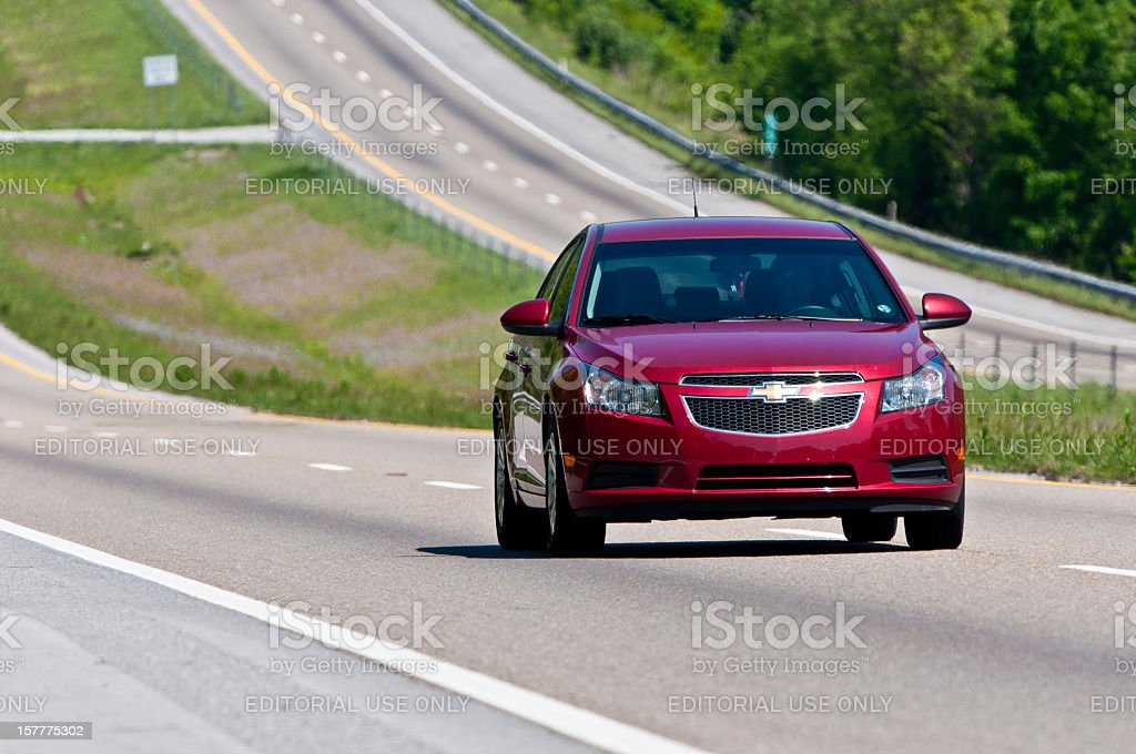 Chevrolet Malibu Changes Lanes On Interstate Highway stock photo