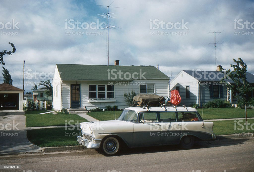 1956 Chevrolet parked in front of 50's home stock photo