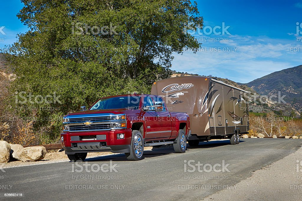 Chevy Silverado pickup pulling Cougar trailer by Keystone stock photo