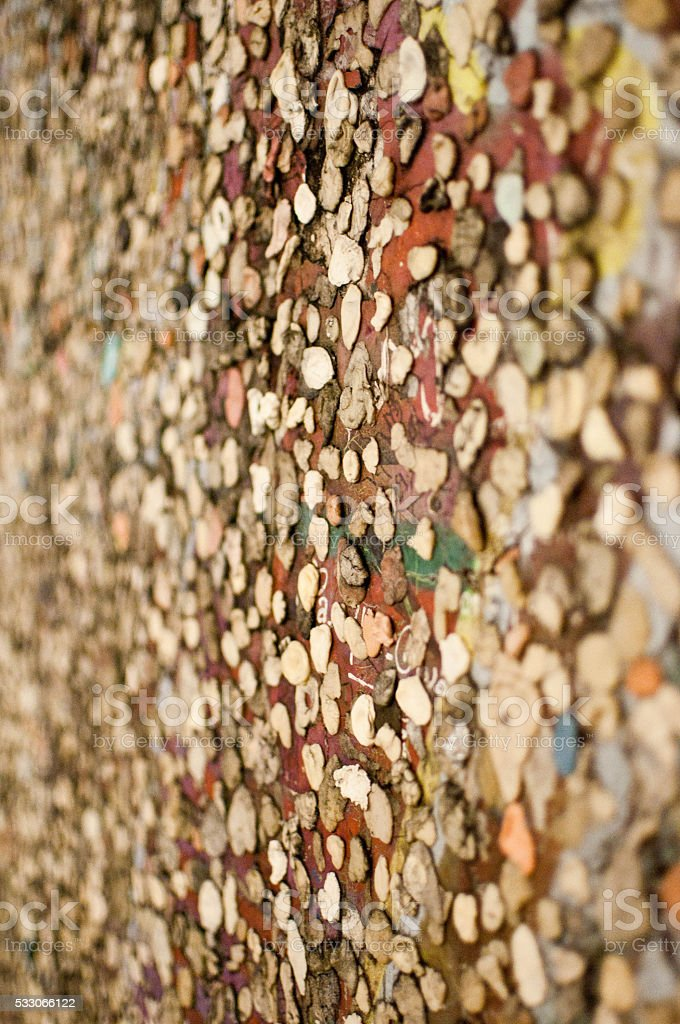 Chewed gum stuck to a wall - Berlin wall fragment. stock photo
