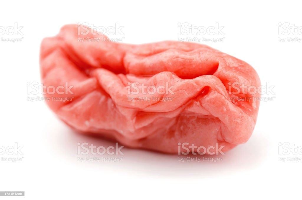 Chewed up gum in white background stock photo