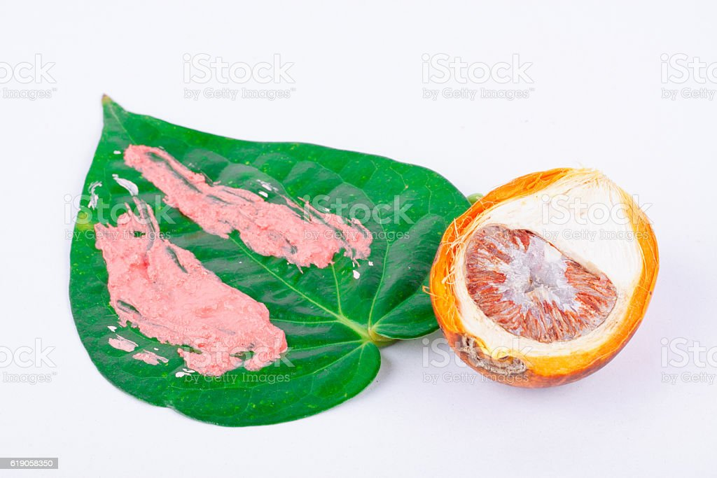 Chewing betel nut and betel and  red lime stock photo