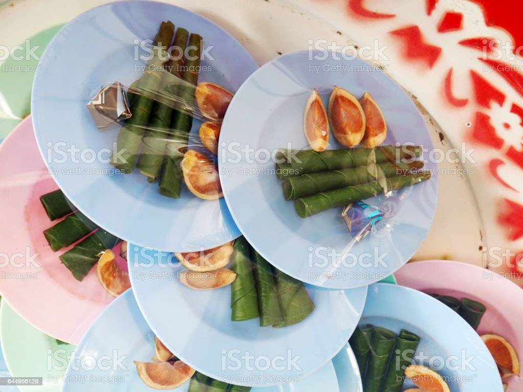 Chewing betel nut with betel leaf, Thailand stock photo