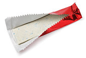 Chewing gum plate in red foil on white