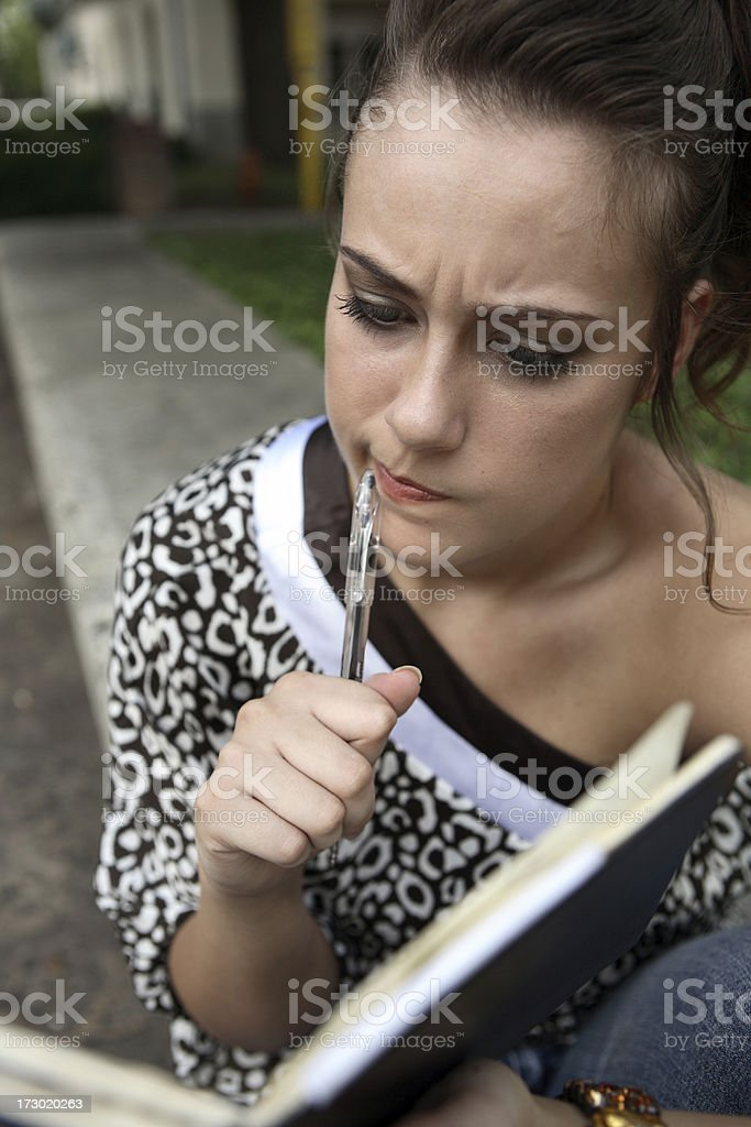 Chewing on pen. royalty-free stock photo