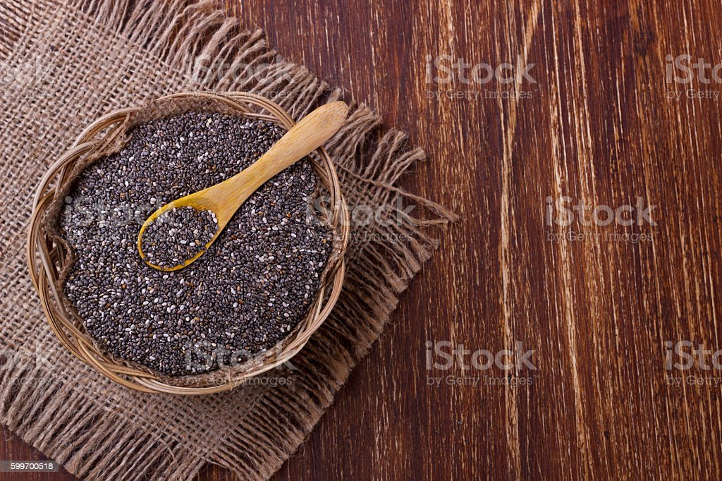 Chia seeds with wooden spoon stock photo