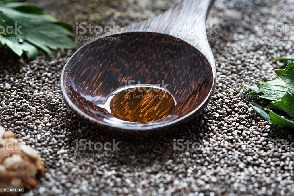Chia seeds wooden spoon oil super food stock photo