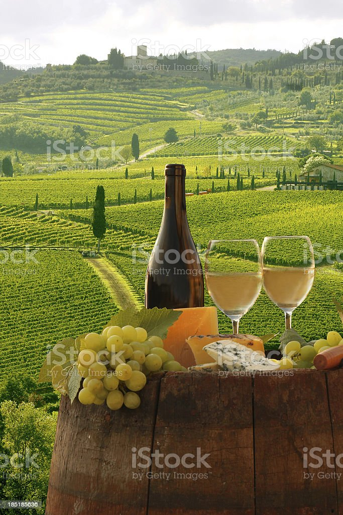 Chianti landscape with bottle of wine in Italy stock photo