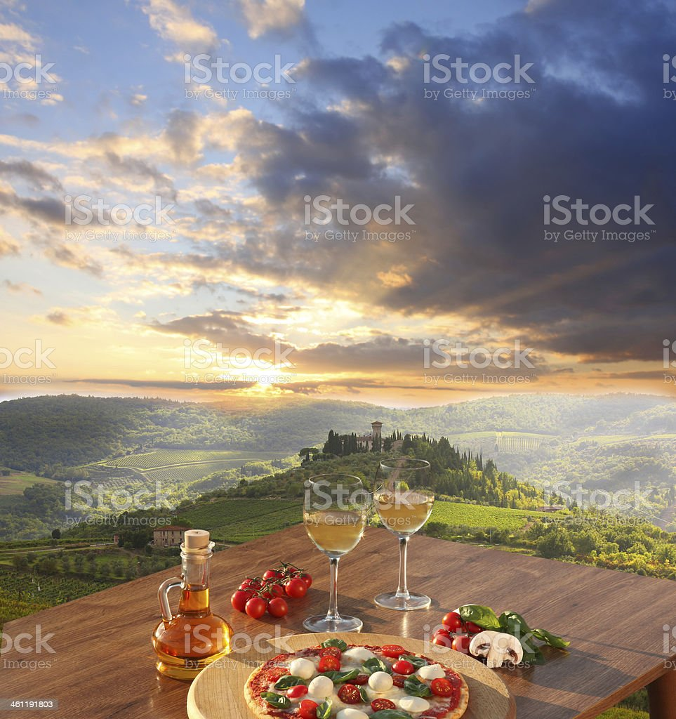Chianti vineyards with  pizza and glasses of white vine, Italy royalty-free stock photo