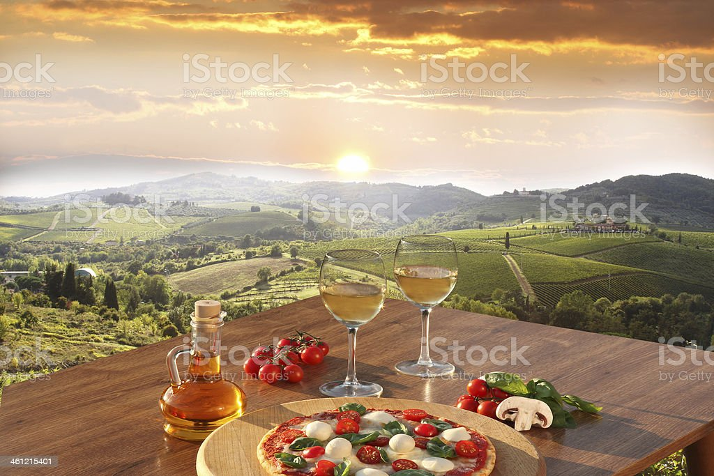 Chianti vineyards with  pizza and glasses of white vine, Italy stock photo