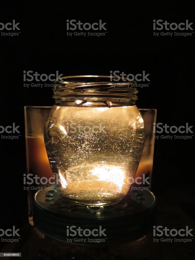 Chiaroscuro with candle and Water stock photo