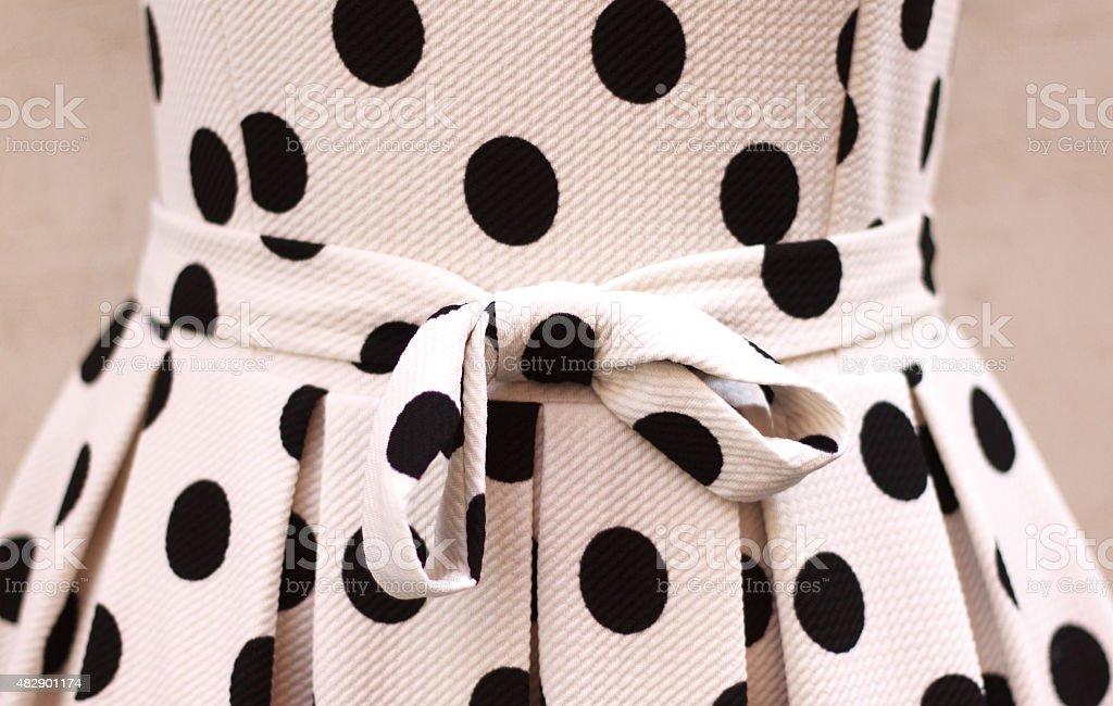Chic Black and White Polka Dot Dress (Waist Detail) stock photo