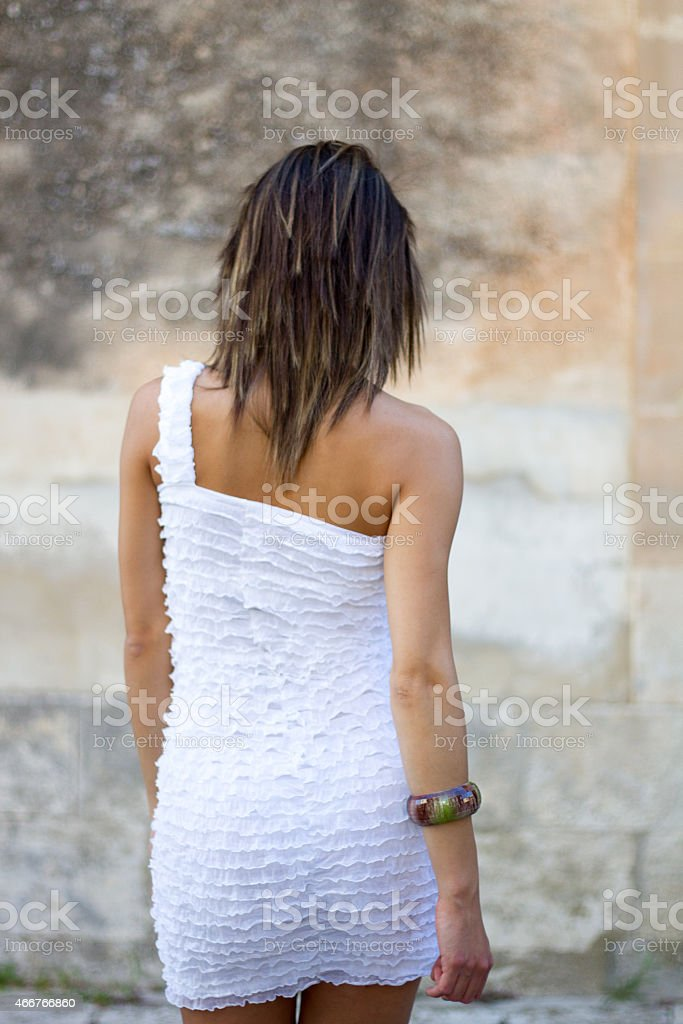 Chic Young Beauty in Sexy White Dress stock photo