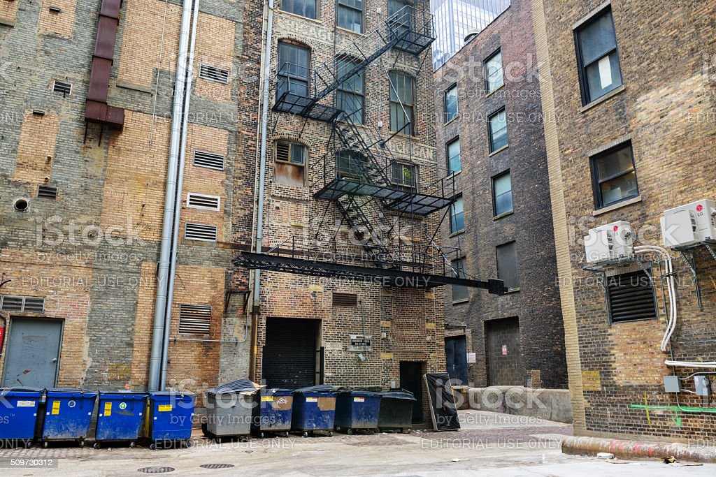 Chicago city alley with dumpsters stock photo