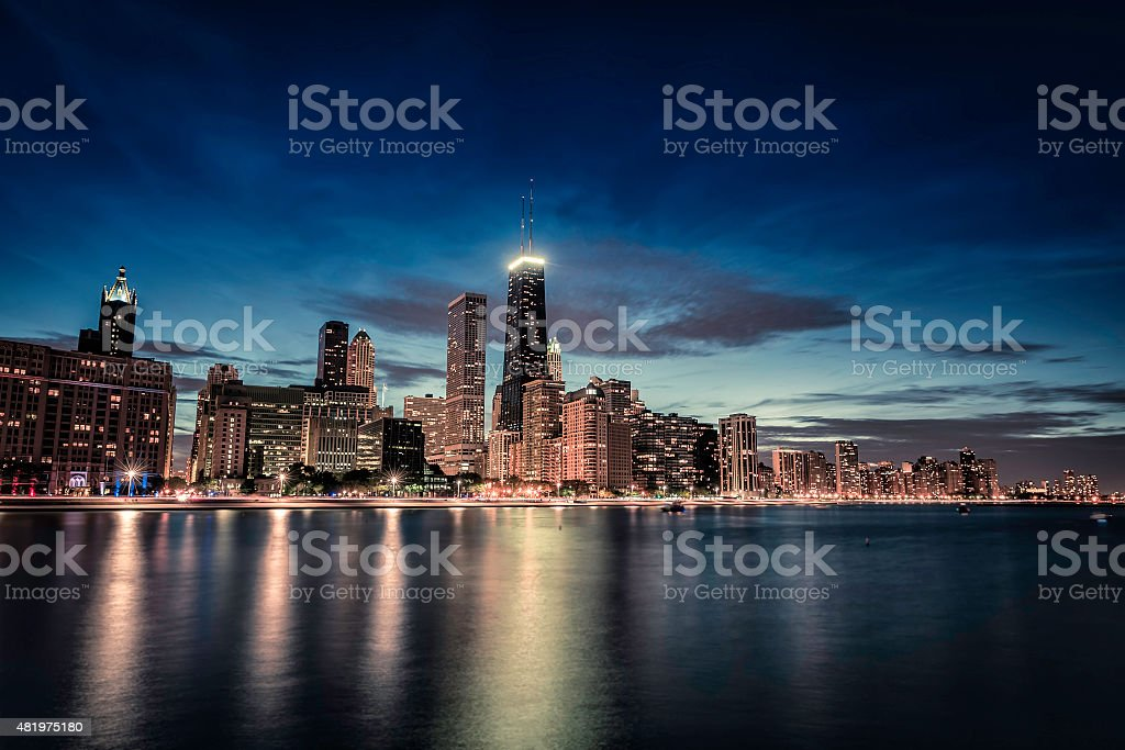 Chicago Downtown skyscrapers with reflections in Lake Michigan a stock photo
