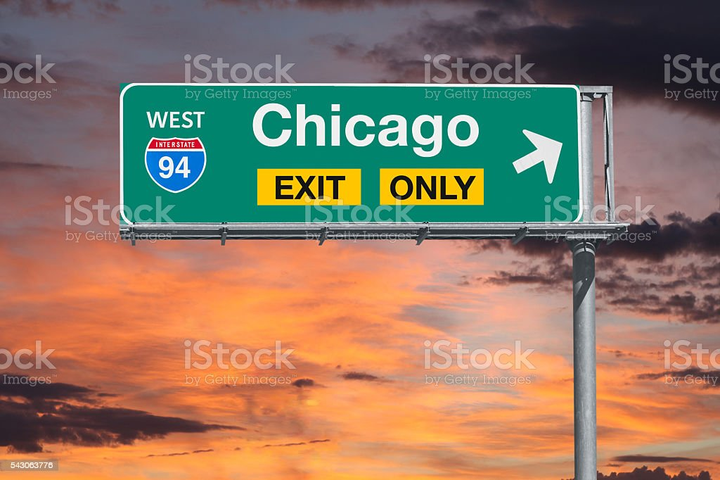 Chicago Exit Only Freeway Sign with Sunrise Sky stock photo