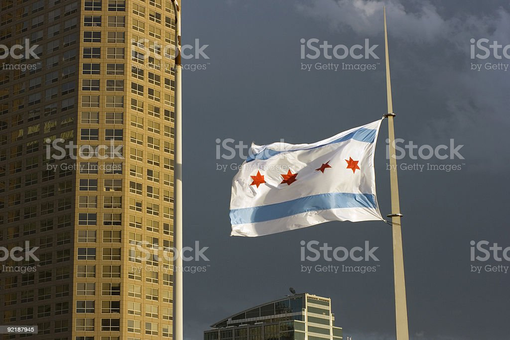Chicago flag against havy clouds stock photo