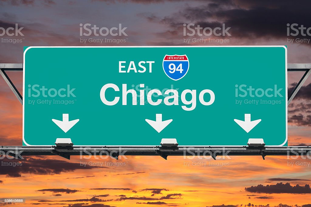 Chicago Interstate 94 East Highway Sign with Sunrise Sky stock photo