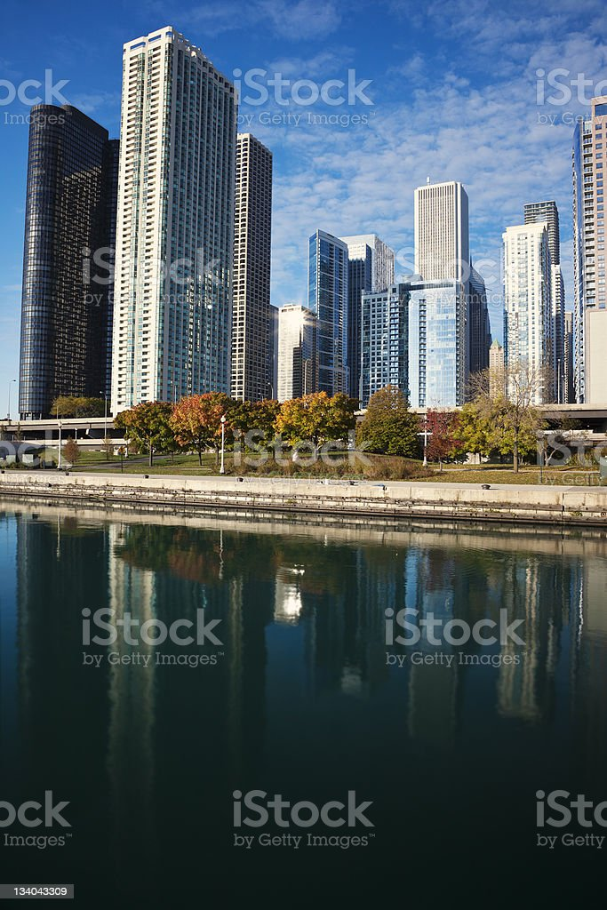 Chicago reflected in Lake Michigan - late fall afternoon. stock photo