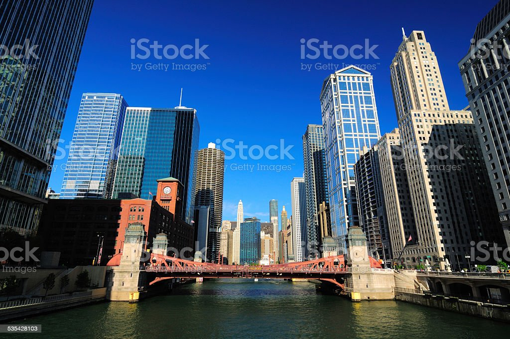 Chicago river in downtown with towering skyscrapers and a bridge stock photo