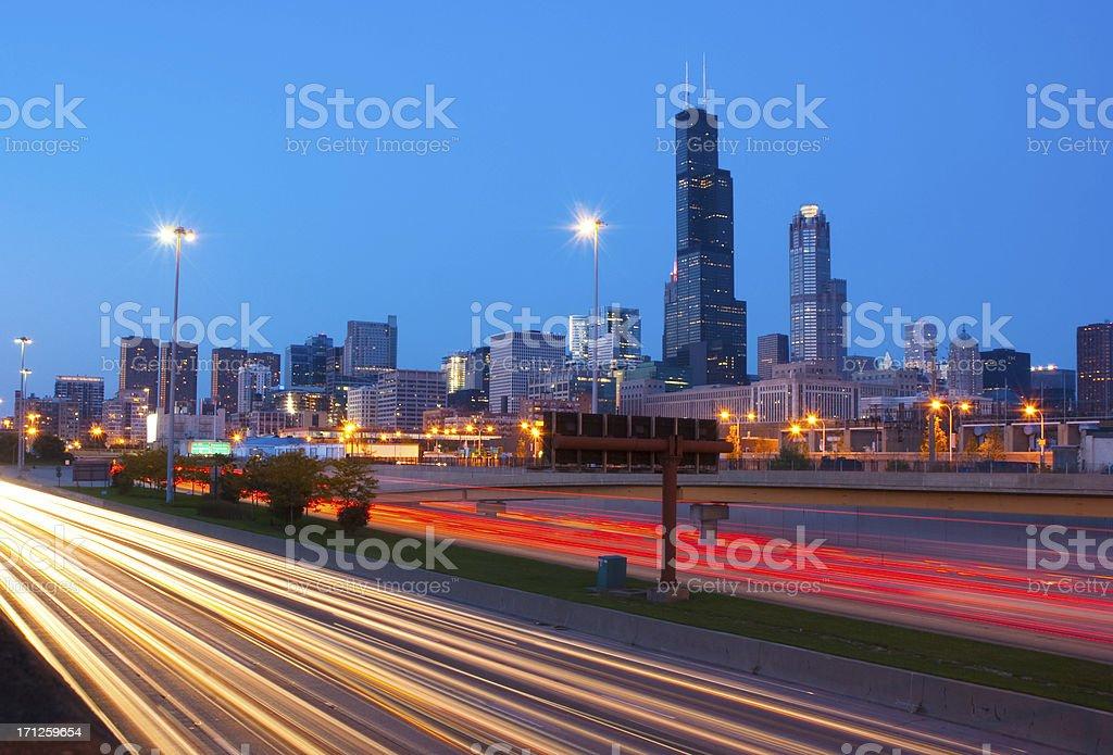 Chicago skyline and freeway at dusk stock photo