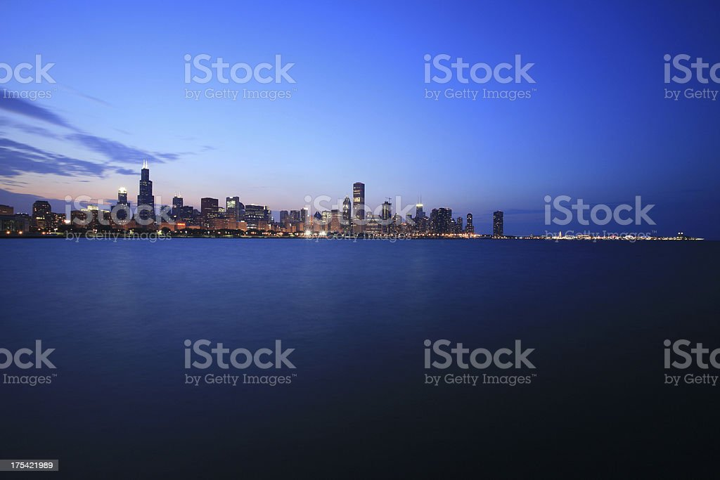 Chicago Skyline and Navy Pier at night stock photo