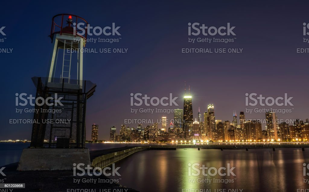 Chicago skyline at night viewed from North Avenue Beach stock photo