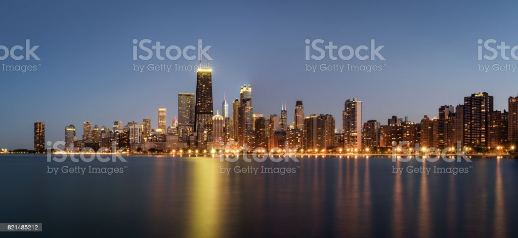 Chicago skyline panorama at night viewed from North Avenue Beach stock photo