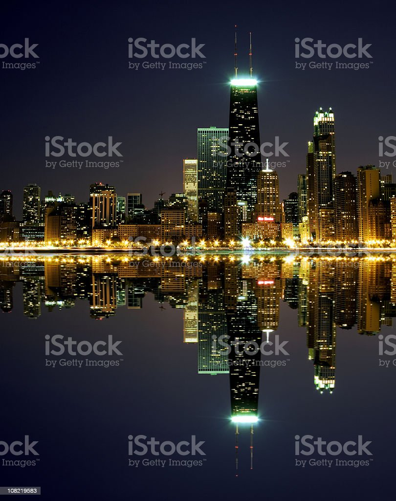 Chicago Skyline Reflected on Lake Michigan at Night stock photo