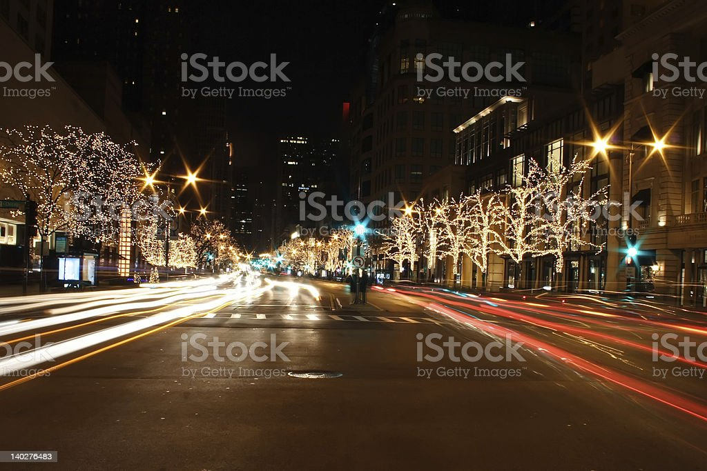 Chicago street lit up at night time with lights in trees royalty-free stock photo