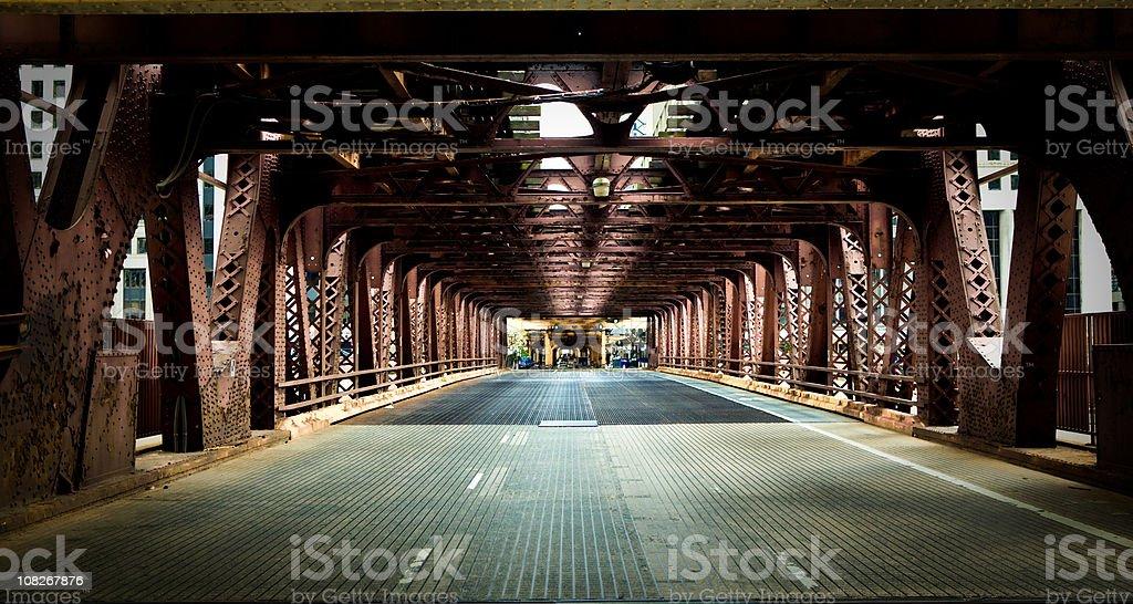 Chicago street under the metal bridge stock photo