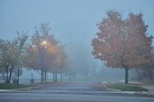 NW Chicago suburb in a dense foggy morning/ night.