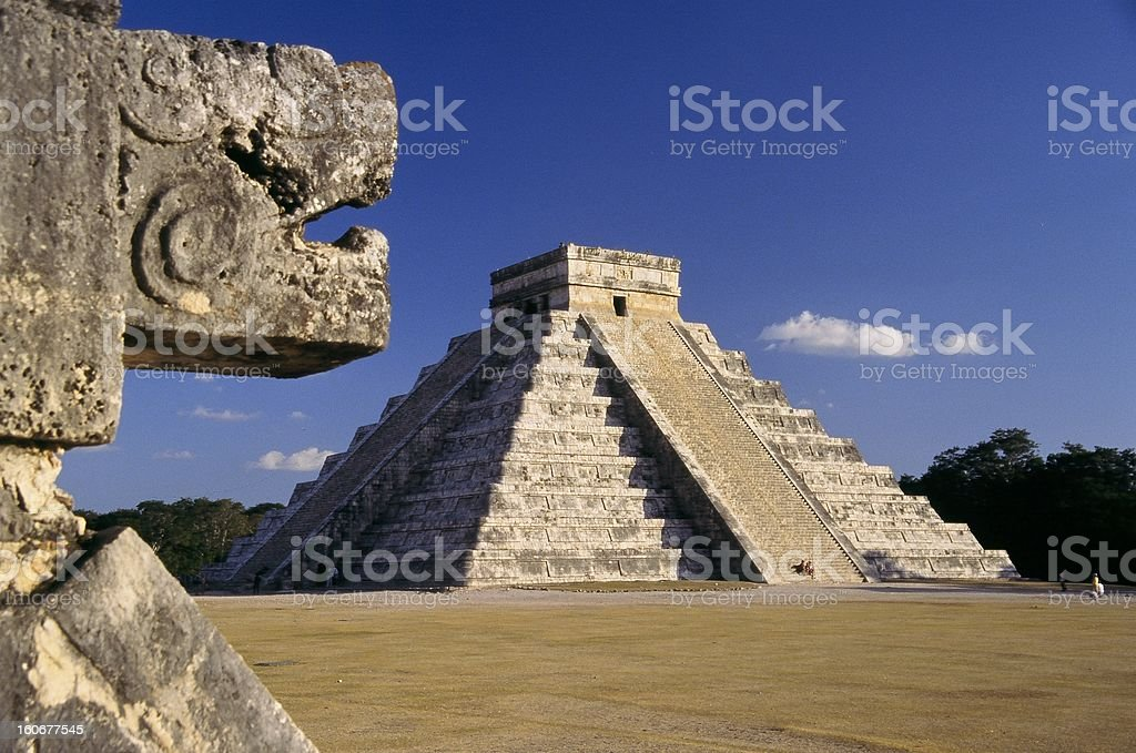 Chichen Itza step pyramid in Mexico with blue sky stock photo